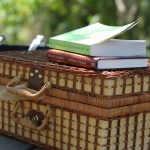 PHOTO: Picnic basket with books on top.