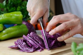 PHOTO: Chef slicing fresh cabbage.