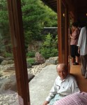 PHOTO: Mr. Tamane sitting by the dry garden around the building where he offered us tea.