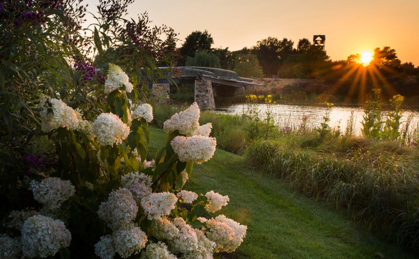 PHOTO: A summer sunset frames the Trellis Bridge in golden glow.