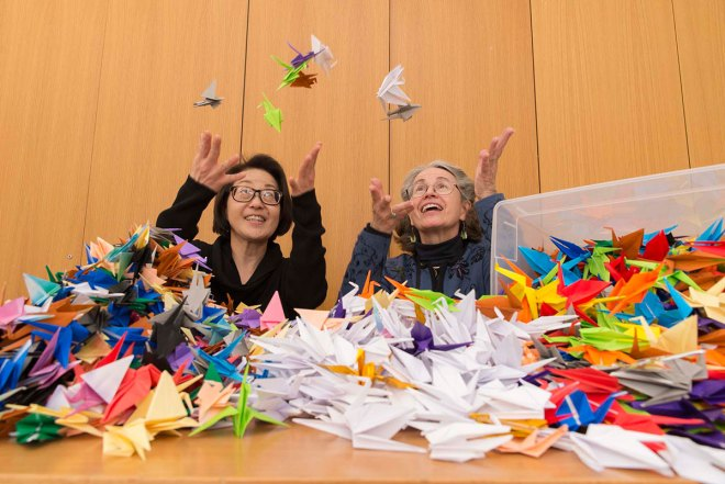 PHOTO: Volunteers Susan and Edie with their stash of origami cranes.