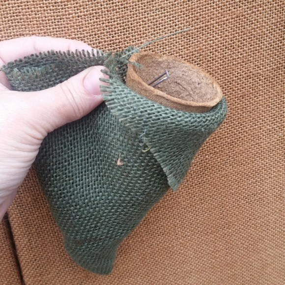 PHOTO: The picture shows a hand holding the fabric to make the pocket fit around the pot.