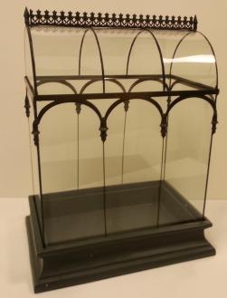 PHOTO: A large Wardian case, made of steel and glass—an individual greenhouse for an orchid.
