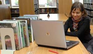PHOTO: Woman with laptop in the Lenhardt Library.