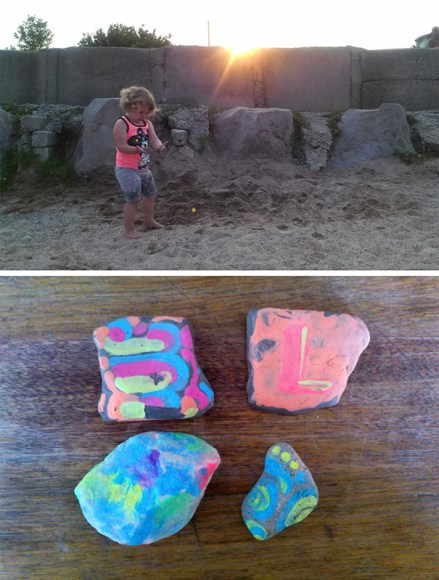 PHOTO: Laila collects stones on the beach; the painted stones below.