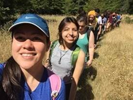 PHOTO: Erica and her fellow students, loaded with backpacks, are hiking up a trail.