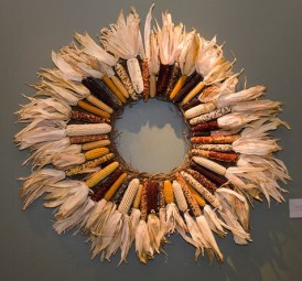PHOTO: Six types of colorful indian corn—husks facing outward as a fringe—create this wreath.