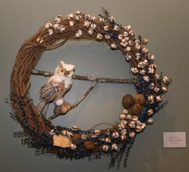 PHOTO: An owl made from natural materials perches in this cotton boll wreath.
