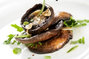 PHOTO: grilled portobello mushrooms, covered in herbs and garlic.