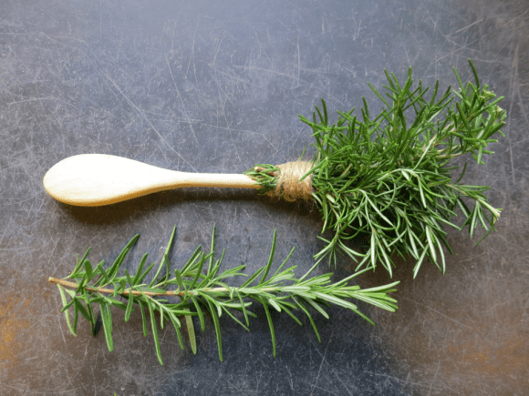 PHOTO: rosemary sprigs tied to a wooden spoon make an herb brush