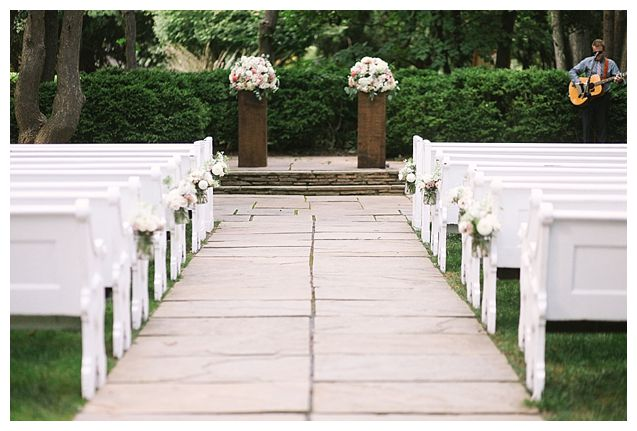 Woodend sanctuary wedding with vintage pews