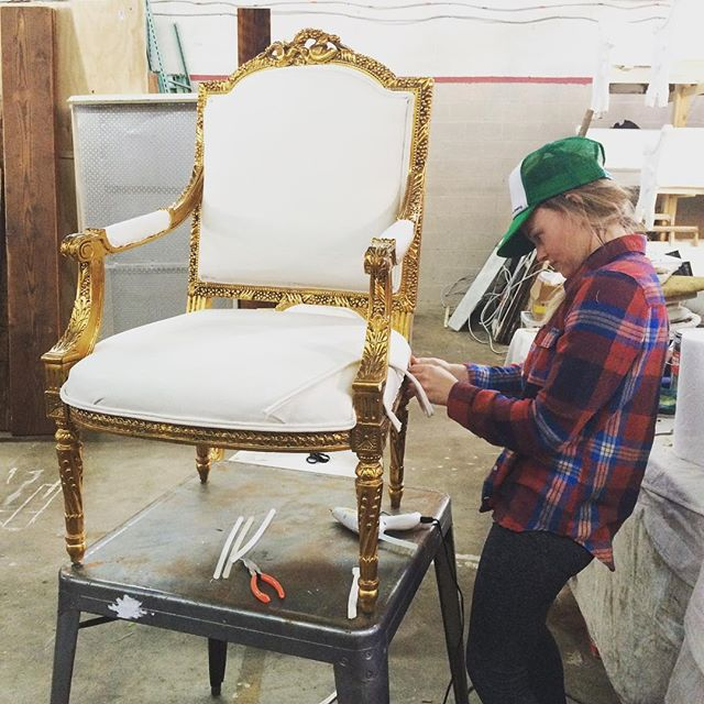 @tiffany2jane hard at work reupholstering our  antique chairs and settee!  I know she hates it when I post her pic, but I gotta brag about her mad skills.  She's a perfectionist and works on beautifying our pieces until they are just right.  Thank you Tiff for all you do for Something Vintage!  Can't wait to show off the matching settee and chair she is working on! #momtrepreneur #girlboss #create .....#upholstery #interiordesign #vintage #vintagerentals #igdc #acreativedc #antique #gold #antiquefurniture #dcwedding #igdc #french #dcevents #dcwedding #risingtidesociety #upholstered #momboss