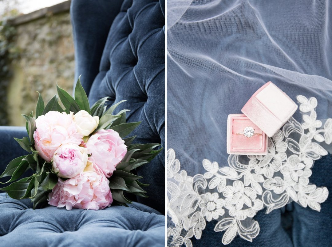 Flowers and wedding ring sitting on navy vintage settee