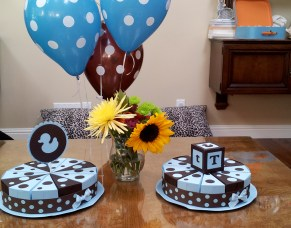 "Two handmade ""Favor Cakes"". Each centerpiece has wedges with favors inside. Guests take one as they leave."