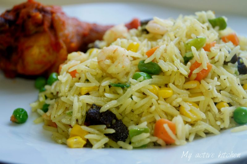 close shot of fried rice loaded with fresh vegetable