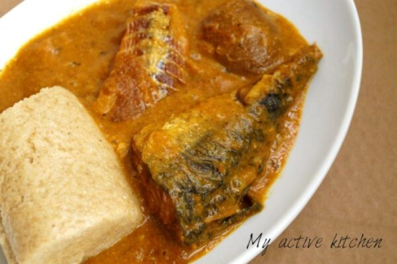 angled overhead shot of ogbono soup loaded with fried mackerel, panla and ponmo
