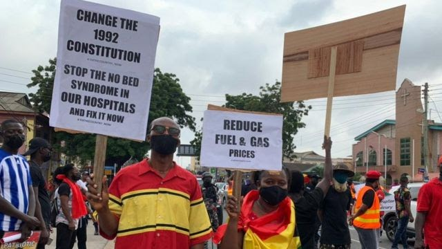 FixTheCountry protest placards with various messages