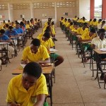 students seated writing exams