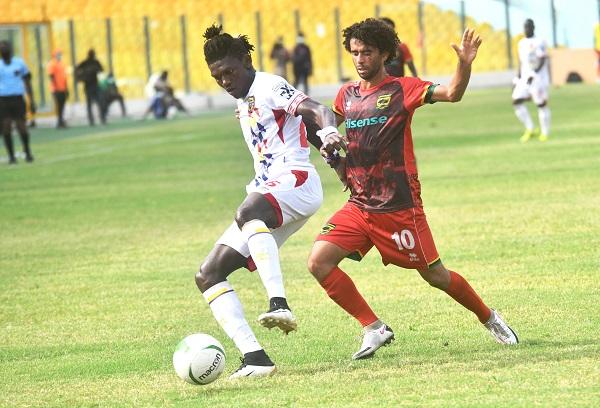 Ibrahim Salifu of Hearts of Oak and Fabio Gama of Kotoko battle for the ball