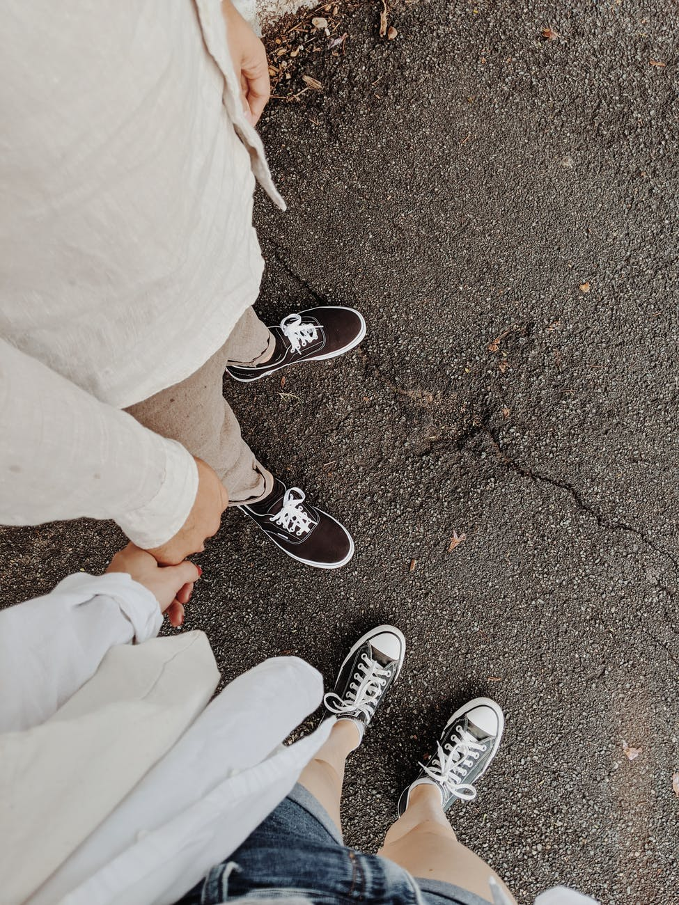 people in black and white sneakers