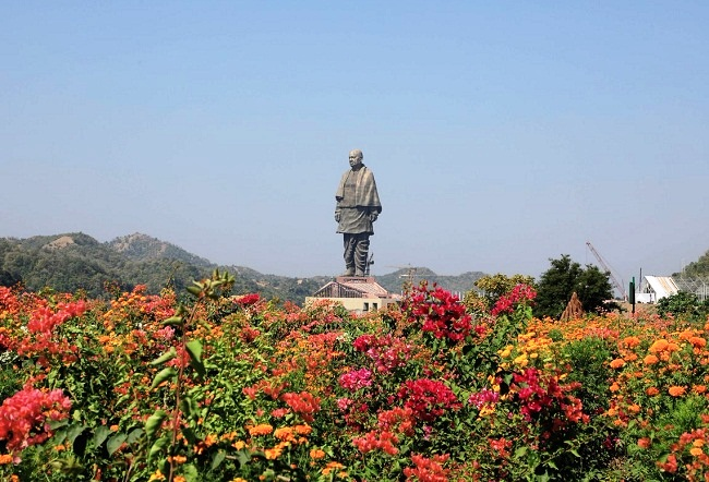 view of statue of unity from valley of flowers