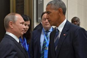 Russian President Vladimir Putin talks to U.S. President Barack Obama during a meeting on Sept. 5, 2016, at the sidelines of the G20 Summit in Hangzhou, China. On Thursday, Dec. 29, 2016, The U.S. ordered 35 Russian diplomats to leave the country within 72 hours, a sanction that is aimed to punish an alleged cyberhack into the 2016 U.S. presidential elections. (ALEXEI DRUZHININ/SPUTNIK/KREMLIN / EPA)