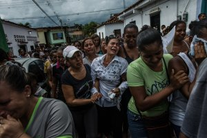 A funeral procession in Capaya, Venezuela, for men killed after raids by the security forces. Credit Meridith Kohut for The New York Times