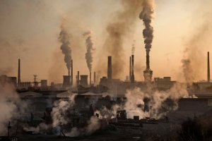 A large steel plant in Inner Mongolia, China, in November. To meet China's targets to reduce emissions of carbon dioxide, authorities are pushing to shut down privately owned steel, coal, and other high-polluting factories scattered across rural areas. Credit Kevin Frayer/Getty Images