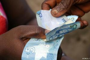 A transaction in the local currency, Cedi
