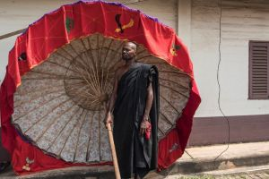 A man carrying a tradionnal umbrella in Kumasi on November 24 at a ceremony following the death of Nana Afia Kobi Serwaa Ampem II A man carrying a tradionnal umbrella in Kumasi on November 24 at a ceremony following the death of Nana Afia Kobi Serwaa Ampem II (AFP Photo/Cristina Aldehuela)