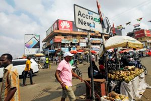 "People walk past vendors and shops in 2016 in Accra, Ghana. In preparation for Ghana's 60th anniversary celebration March 6. Members of the Ghana Bishops' Conference have called on Ghanaians to continue to make the nation truly the ""Star of Africa,"" a symbol of hope for Africa's total liberation. (Credit: CNS photo/Luc Gnago, Reuters.)"