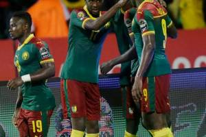 Cameroon's Ngadeu Ngadjui Michael, and teammates celebrate after he scored a goal against Ghana during the AFCON Semi-final match