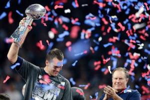 Tom Brady reacts with the Vince Lombardi Trophy after winning the NFL Super Bowl 51 football game against the Atlanta Falcons Sunday, Feb. 5, 2017, in Houston. Right is Patriots head coach Bill Belichick, who along with Brady won a record five Super Bowls. The Patriots won 34-28. Darron Cummings AP