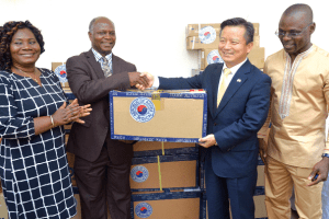 Mr Woonki Lyeo (2nd right) making the presention to Dr Ebenezer Appiah-Denkyira (2nd left). Looking on are Dr Linda Vanotoo (left), Greater Accra Regional Director of GHS, and Dr Thomas Anabah, Medical Director of the hospital. Picture by Emmanuel Quaye
