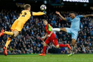 Raheem Sterling, right, attempting to put the ball past Liverpool goalkeeper Simon Mignolet during the clubs' 1-1 draw on Sunday. Credit Andrew Yates/Reuters