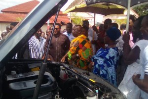 Okyene inspecting the SUV