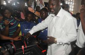 Soccer Star, George Weah casts his vote during presidential election in Liberia