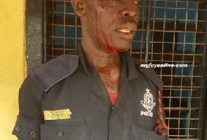 Police Officer beaten up by some military men