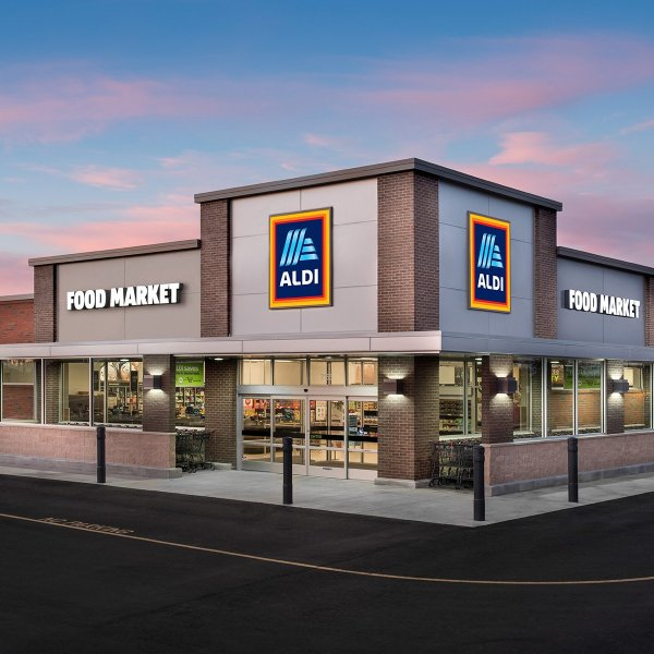 Aldi food market with lights turned on.