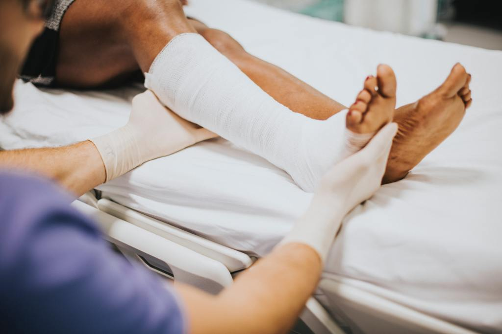 An adult being treated for a foot injury.