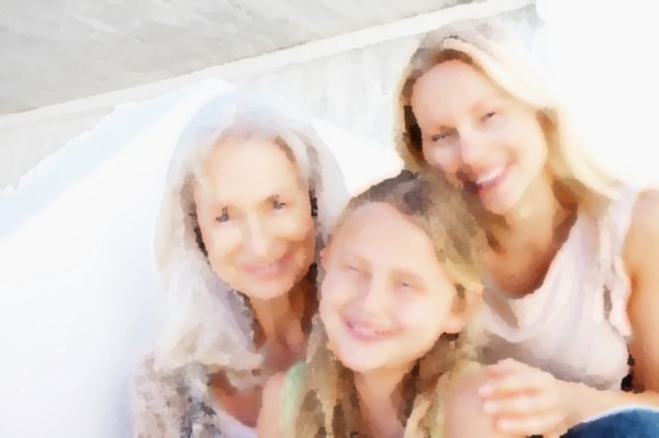 Portrait of a cute granddaughter with mother and grandmother