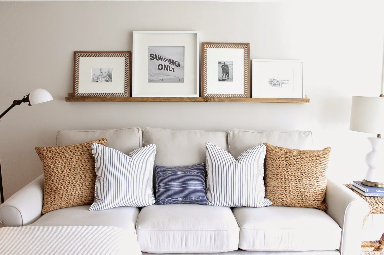 decorating ideas for living room with brown couch beach furniture amazing picture ledge creating a statement wall ...