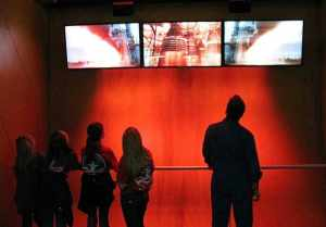 Five people stand inside the blast off simulator at the US Space and Rocket Center