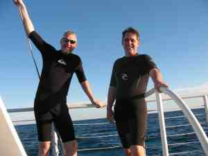 Malcolm Logan and Tim Lincoln aboard a catamaran off Key West