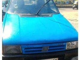 His second - '94 fiat uno s light blue - photo courtesy of http://imganuncios.mitula.net/