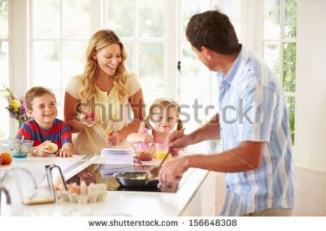 stock-photo-father-preparing-family-breakfast-in-kitchen-156648308