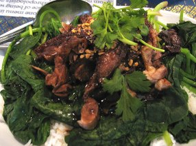 Roast duck over steamed rice. This was ordered so that the almost-2 year old could have something to eat, but frankly it was a relief to be able to turn to it occasionally from the fireworks elsewhere on the table. It came with a wonderful spicy dipping sauce made with tamarind (with sliced hot chillies marinated in it), and a bed of greens between the duck and the rice.