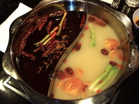 ere is our Hot and Fresh pot as it came out of the kitchen and placed on the burner. I hope you can see from this why you should not plan to eat the chilli broth at the end of the meal. I think the chilli broth here has fresh rather than dried Sichuan peppercorns at the bottom.
