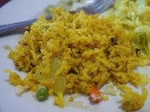 At least I hope this was not intended to be lemon rice. I think it was a veg biryani. If so, you could probably make a better biryani, never having tasted any biryani before, using the instructions on the back of a biryani masala box.