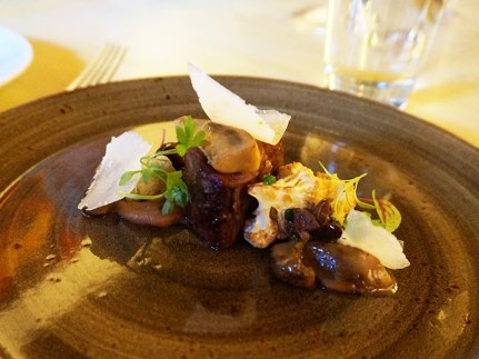 Grilled lamb leg with porcini mushrooms, fried cauliflower and Marcona almonds